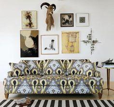 Ikat sofa, striped rug and cool art display.
