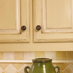 Southern Living Kitchen Makeover on a Budget. Painted, glazed, distressed cabinets.