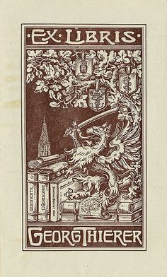 Ex Libris of Georg Thierer ~ Pratt Institute Library ~ depicts a beast with a sword standing on top of a stack of books under a tree with various shields. Unsigned.