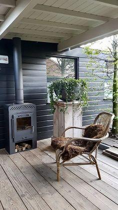 Styling at De Wemelaer part the veranda different - De Wemelaer - Wood stove pillar wicker chair with fur Lia - Outdoor Fire, Outdoor Living, Outdoor Decor, Outdoor Lounge, Patio, Backyard, Summer House Interiors, Contemporary Garden Rooms, Porch Veranda