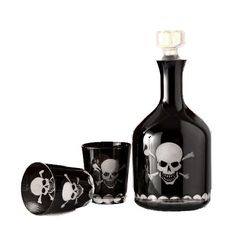 Captain Jack Decanter set made of black glass with clear skull & crossbones