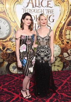 Anne Hathaway in Christopher Kane and Mia Wasikowska in Alexander McQueen attend Disney's 'Alice Through the Looking Glass' premiere on May 23, 2016 in Hollywood