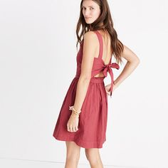 "A sunny-day dress with an undeniably pretty back detail—it ties in a bow above a peekaboo cutout. Garment-dyed for a perfectly worn-in finish, this apron style is one you'll reach for all season long.<ul><li>Waisted.</li><li>Falls 29 1/4"" from highest point of bodice.</li><li>Cotton.</li><li>Lined.</li><li>Machine wash.</li><li>Import.</li></ul>"