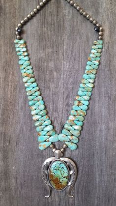 This necklace features a large Naja with one large Turquoise stone and the strands of the necklace feature alternating teardrop turquoise stones. There are 45 individual teardrops on each side of the necklace. | eBay!