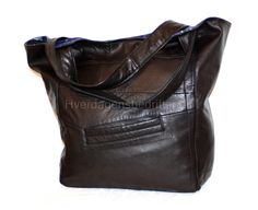A shopper bag made of a leather jacket.