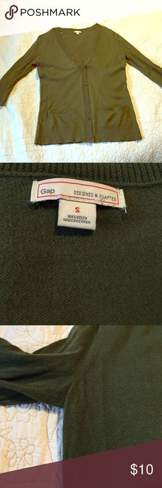 Lovely olive green Gap 3/4 sleeve cardigan S Size small. Great olive green color with mild signs of wear (slight pilling under arms). Lightweight and perfect over an oxford. Make an offer or bundle-offer! GAP Sweaters Cardigans