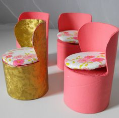 Barbie chair made from toilet paper rolls. Might work as a vanity chair. Also made 4 curved high back chairs from Pringles chips cans, painted black. Need to add cord around cut edges & seat cushions - bigger seats will fit the male dolls better.