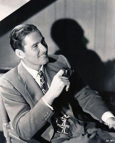 Errol Flynn photographed by Elmer Fryer, 1934.
