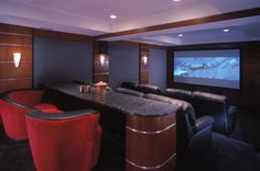 interesting movie theater room ideas with black leather loveseat unique red armchair bar table wall lights ceiling lamps wall mounted LED TV wall mounted speaker and wall to wall carpet Living Room Theaters Ideas With Cozy Sofa