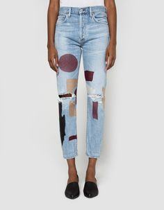 In an exclusive collaboration between Need Supply Co. and Citizens of Humanity, stylized jeans in a light wash Torn. Button fly. Classic five-pocket styling. Branded buttons and rivets. Modern embroidered geometric details at legs. Moderate distressing th