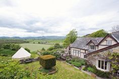 We love this place, it's ancient inside with swishy modern bathrooms and a great bell tent for the kids in the garden