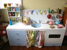 Child's play kitchen, made from an old desk. So much cooler than my plastic one