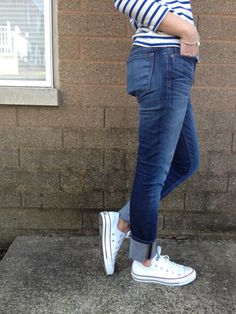 striped long sleeved shirt + cuffed blue jeans + white low-top Converse