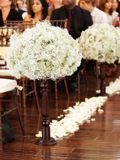 7 Creative Ways to Decorate Your Wedding Ceremony Aisle 6. All-White Formal Flower Arrangements – The Knot