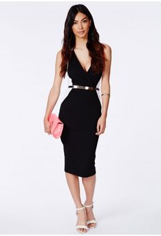 We're obsessing over monochrome for SS14, it's a surefire way to bring an outfit right up to date. This bodycon wrap piece is a great way to work it, a totally sophisticated piece. Style with a pair of stilettos and a clutch.  Belt includ...