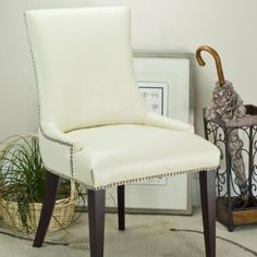 Becca Dining Chair - Beige Linen - Grandin Road by Grandin Road. $299.00. Fabric cover should be spot cleaned. Read more about bi-cast leather care. From Safavieh Home Furnishings. Solid wood frame and legs. Choose bi-cast leather or 100% linen upholstery. From Safavieh Home Furnishings. Solid wood frame and legs. Choose bi-cast leather or 100% linen upholstery. Fabric cover should be spot cleaned. Read more about bi-cast leather care. Trimmed with elegant nai...