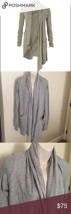 All Saints Asymmetrical Cardigan Sweater Grey  10 This is a gorgeous and super comfortable All Saints Cardigan. It is great ribbed and smooth fabric. Asymmetrical in front and back. Made of 100% cotton. Heather grey size 10. Large front pockets. All Saints Sweaters Cardigans