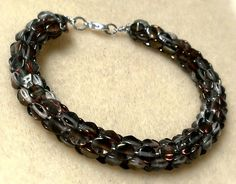 Pinch Bead Kumihimo Bracelet made with roughly 27-30 pinch beads per side of cord