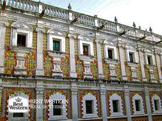EL MEJOR HOTEL EN PUEBLA. Uno de los edificios más bellos de Puebla es La Concordia, el cual fue construido en 1676 y posee un estilo barroco poblano. Su característica principal es la combinación de su fachada de cantera con piezas de santos realizadas en mármol, además de bello patio lleno de azulejos de colores. En Best Western Real de Puebla, le invitamos a hospedarse con nosotros y conocer esta imponente joya arquitectónica. #bestwesternpuebla