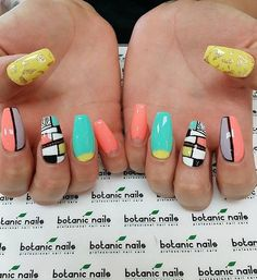 Pretty abstract nail art design in pastels.  This combination of light colors with the black lining that separates the shapes makes the design look even more interesting.