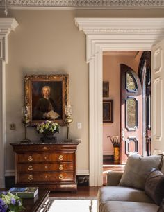 Charleston - Traditional - Living room - Images by SLC Interiors. Love the door in the foyer!