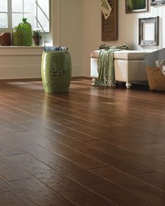 Chestnut Hill™ winchester color evokes the charm and rustic appeal of quintessential historic design. This inspiring hand-scraped engineered hardwood
