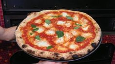 Delaware: Margherita at DiMeo's Pizzaiuoli Napulitani in Wilmington --- Imported San Marzanos, buffalo mozzarella, basil and extra virgin olive oil on a quick-fired wheat, salt and water crust.
