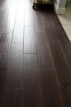 This is tile flooring...made to look like wood. So pretty! #flooring ...
