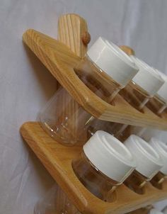 Wooden Spice Rack Oak 16 jar shelves of 4 jars) 11 wide by high and 4 from the wall to the front of the jars. This hanging spice rack mounts on the wall or on the inside of a cabinet door. Spice Rack Oak, Spice Rack Mounted, Hanging Spice Rack, Wooden Spice Rack, Woodworking Furniture, Diy Woodworking, Wood Furniture, Woodworking Organization, Woodworking Quotes