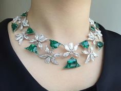 """magnificent emerald and diamond necklace offered in our Hong Kong Magnificent Jewels auction. This """"Palmette"""" necklace set with exquisite Colombian emeralds is designed by Edmond Chin for Emerald Jewelry, Diamond Jewellery, Modern Jewelry, Necklace Designs, Beautiful Necklaces, Fashion Jewelry, Jewelry Design, Pendant, Colombian Emeralds"""