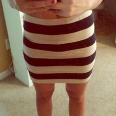 Tan/Off white and black striped tight skirt! Size medium but can fit a small, tight fitted skirt. Super comfortable and stretchy, not see through. Perfect condition Skirts