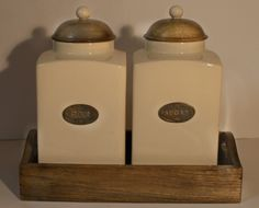 Country Kitchen Ceramic Flour and Sugar Storage Jars with Wooden Lids and Ceramic Handles and Stamped Metal Labels on a Wooden Tray £45.00. Visit www.englishcountrystoress.co.uk to order