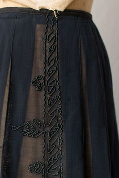 1900s black skirt - applied soutache braid..folds in sheer