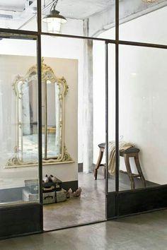 Steel windows & door, gilded mirror, timber side, industrial pendant, love the combination.