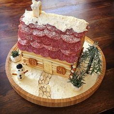 Win Christmas Dinner With A Savory Charcuterie Chalet - Nancy Zylka - Win Christmas Dinner With A Savory Charcuterie Chalet Win Christmas Dinner With A Savory Charcuterie Chalet - Savory Charcuterie gingerbread house - Halloween Gingerbread House, Gingerbread House Kits, Gingerbread House Parties, Gingerbread Decorations, Christmas Decorations, Christmas Appetizers, Christmas Treats, Christmas Parties, Holiday Treats
