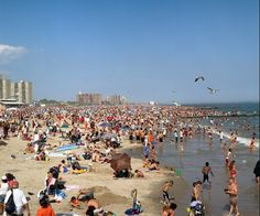 Coney Island beach!  This is how I remember the beach as a kid crowded and  more crowded (Coney Island, Brooklyn.)