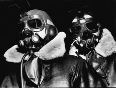 Pilots of American 8th Bomber Command wearing high altitude clothes, oxygen masks and flight goggles at an airdrome in southern England during WWII