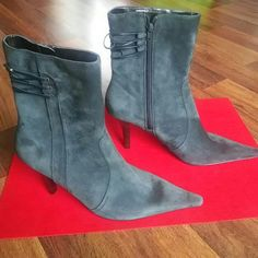 Nine West Boots Amazing Nine West mid-calf pointy toe boots with 3 inch heel. Brand new with no wear on sole. Boots are a charcoal-black color. Style is Underhillo from Nine West. Boots have a cute man made leather strap design on back. Nine West Shoes Heeled Boots