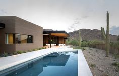 Rammed Earth Modern / Kendle Design. Rammed earth homes fit the southern Arizona Sonoran desert very well. Should last centuries.