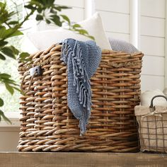 Stack firewood in the living room or offer a spare throw and pillows at the foot of the guest bed with this woven rattan basket.  Pr...