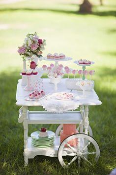 white and pink dessert filled tea cart