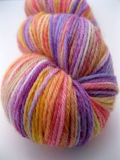 """(sold) Hand Dyed Yarn """"Fruit Fizzer"""" - Sport Weight Yarn in yellow, orange, red, pink, purple by Spacefrog Yarns on Etsy"""