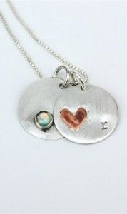 round silver pendants with stone and heart.