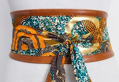 A personal favorite from my Etsy shop https://www.etsy.com/uk/listing/287377773/tan-leather-ankara-turquoise-gold-print