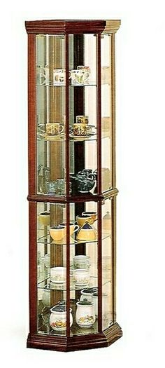 """Corner curio Cherry finish wood curio cabinet with glass shelves, mirrored back and glass doors, Cabinet measures 16 1/2"""" x 16 1/2"""" x 72"""" H. Some assembly required. SKU 3393"""