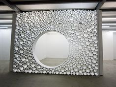 Room divider made of silver toned tubes