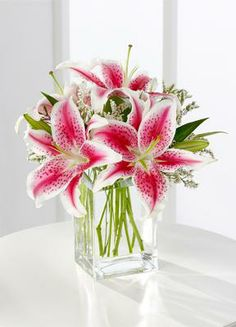 My favorite flower: stargazer lily. Since her name will be Lillie, this would be a great table centerpiece at my shower. Use fabric flowers instead to cut down on costs!