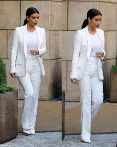 Kim Kardashian does all white with a beautifully tailored suit for a clean #WhiteOut  with a sleek pony tail for a clean finished look
