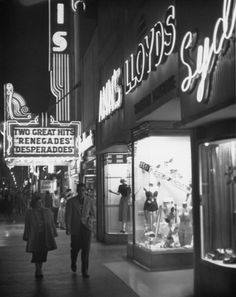 A couple taking in the night air, Hollywood Boulevard, 1959.