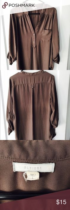 Pleione Brown Tunic Light brown tunic featuring button details on front and adjustable 3/4 length sleeves. Perfect with leggings or tucked into jeans or slacks for work Pleione Tops Blouses
